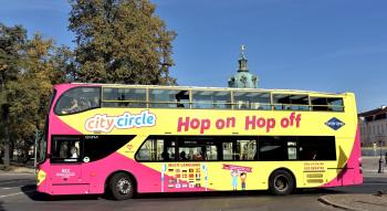 Berlin Sightseeing: yellow City Circle Tour bus at Charlottenburg Palace