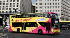 Berlin Sightseeing: City Circle Tour doubledecker coach on Potsdamer Platz.